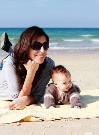 mother with her baby at seashore photo