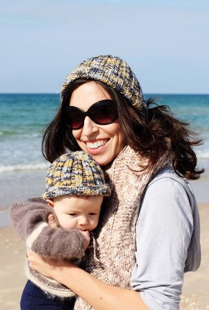 mother with child on the beach photo