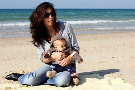 mother with her child on the beach Stock Photo - 12441607