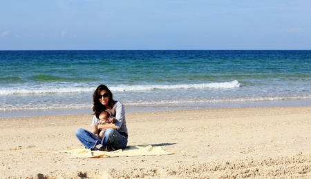 mother with her child on the beach photo