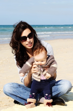 mother with her child on the beach Stock Photo - 12441476