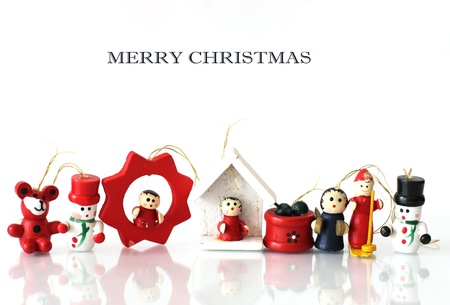 Wooden Christmas toys on a white background photo