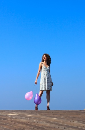 young girl walks and waves the balloons Stock Photo - 12441527