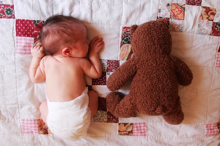 5 days old baby with toy photo