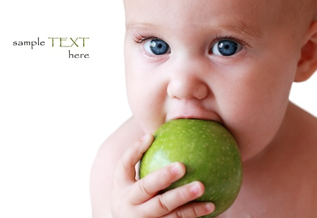 child holding a green apple