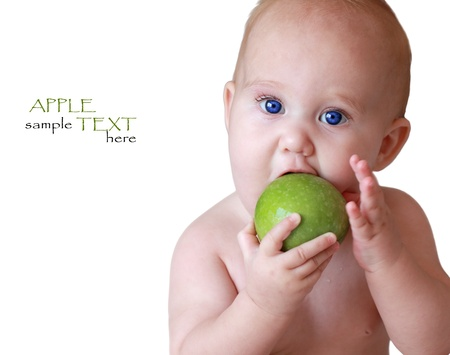 child holding a green apple photo
