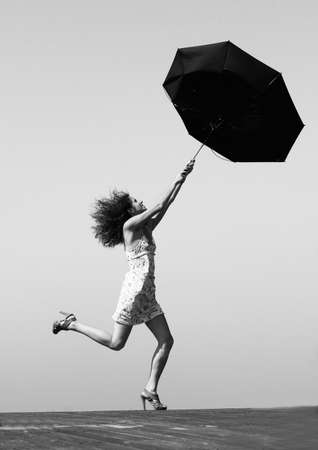 young girl is fighting with wind Stock Photo - 12441712