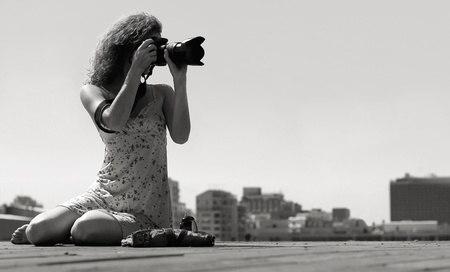 woman beach dress: young girl with a camera