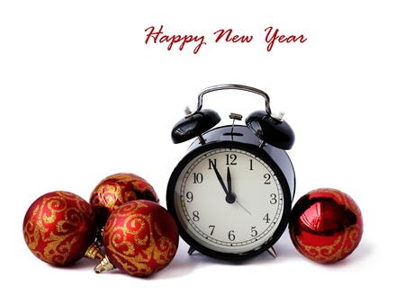 red Christmas balls and alarm clock. 5 minutes before the New Year. photo