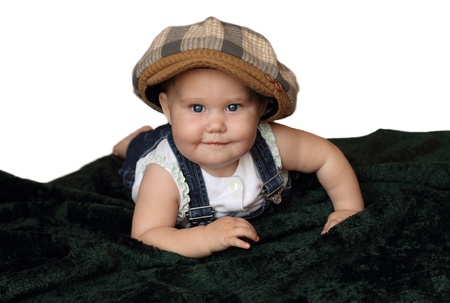 funny 8-month-old baby in the cap photo