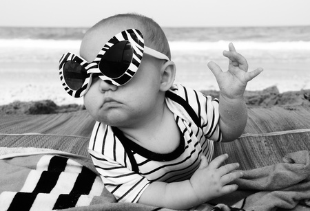 fashion baby on seaside Stock Photo - 12441442