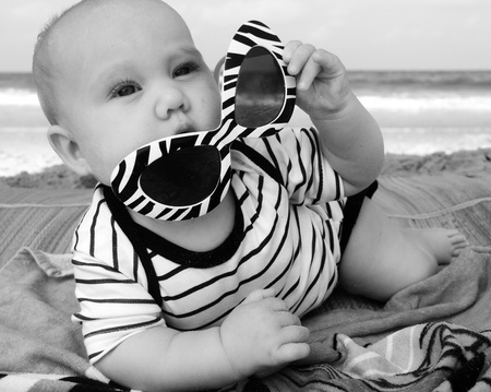 dream body: fashion baby on seaside Stock Photo