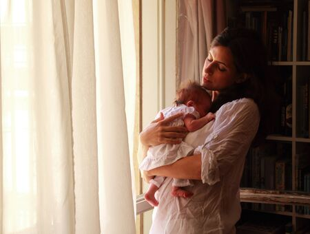beautiful young mother is holding her newborn baby Stock Photo - 12441451