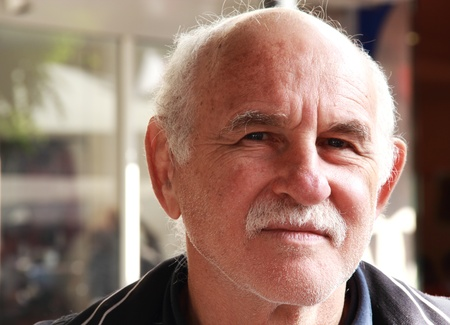 elderly man: handsome elderly man in the street. portrait