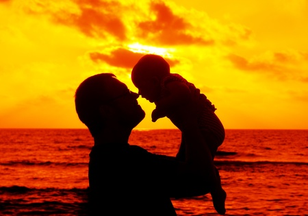 Dad with baby on sunset
