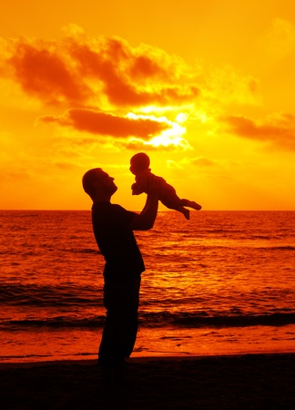 Dad with baby on sunset photo