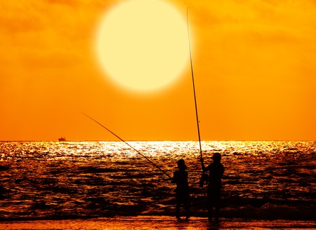 Fishing at sunset photo