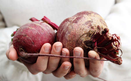 simple life: woman holding a beet  Concept - Simple Life  Stock Photo