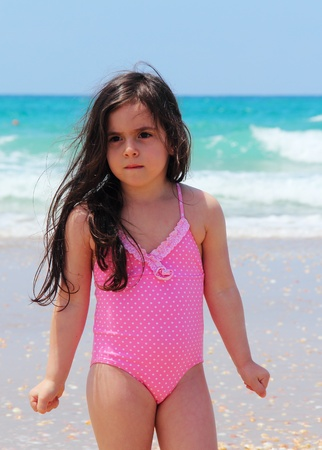 beautiful girl 5 years old on the beach photo