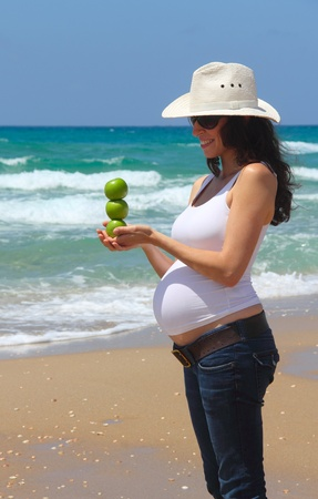 pregnant young woman at the sea photo