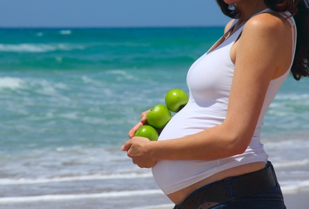 pregnant young woman at the sea Stock Photo - 12693912