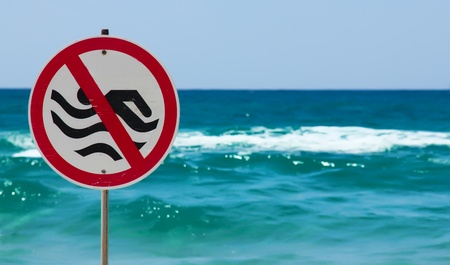 no swimming sign: No swimming sign on a beach
