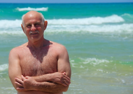 60-year-old man resting on the beach photo