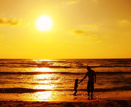 father and son on the sea photo
