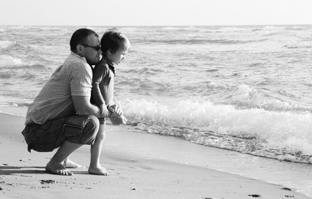 kid's day: child with his father at sea