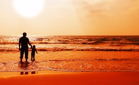 father and son on sunset photo