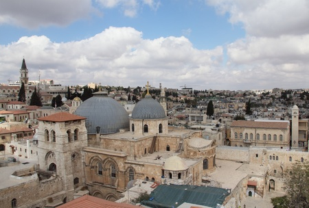 Nice view of the Christian Quarter of the Old City of Jerusalem  Holy Sepulcher against the blue sky and clouds  photo