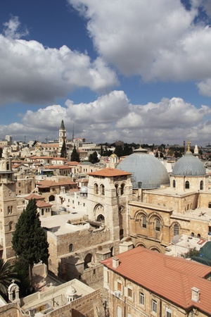Nice view of the Christian Quarter of the Old City of Jerusalem  Holy Sepulcher against the blue sky and clouds Stock Photo - 12695129