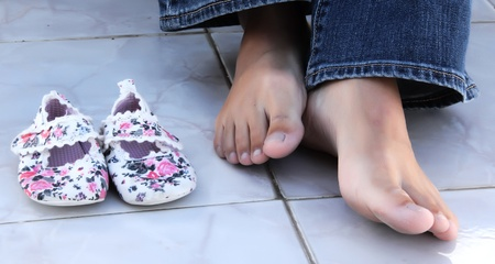 big feet and small children shoes photo