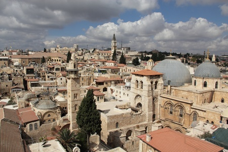 Nice view of the Christian Quarter of the Old City of Jerusalem  Holy Sepulcher against the blue sky and clouds