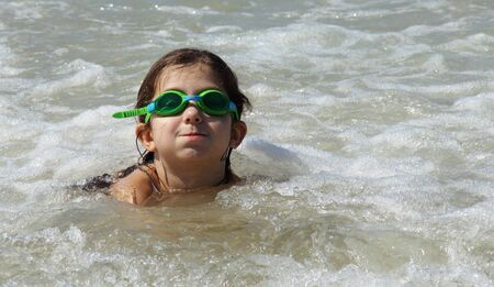 beautiful, funny, girl seven years at sea  There is no front teeth  She is wearing glasses for swimming photo