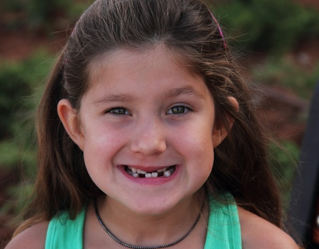 toothless: Smile of small toothless girl