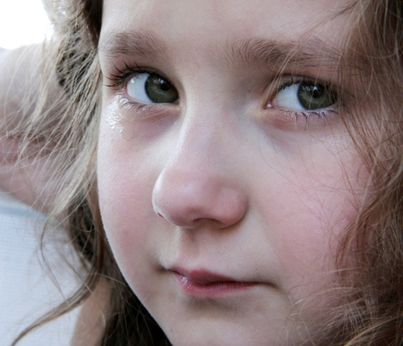 Portrait of cute small girl crying  photo