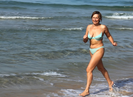 Senior woman In Fitness on the Beach
