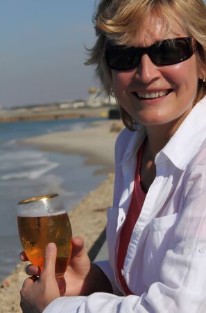 closeup of happy senior woman on beach  photo