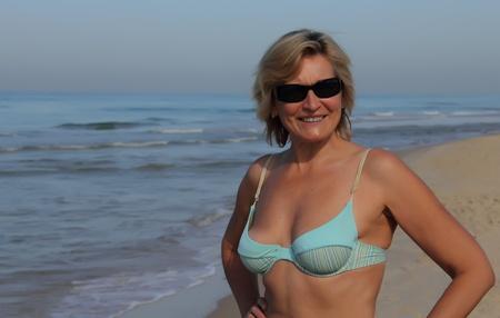 one senior adult woman: attractive senior woman on the beach