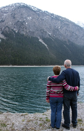 Lovely senior couple near the alp photo