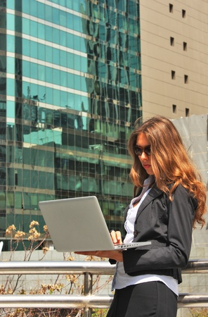 beautiful young business woman in the big city photo