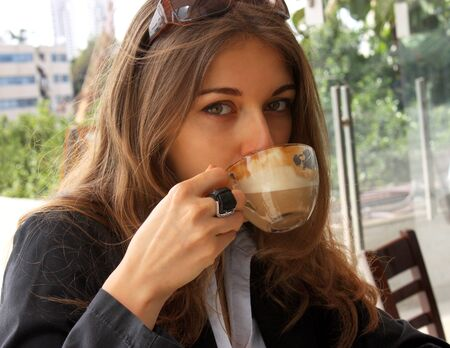 beautiful young woman with cup of coffee photo