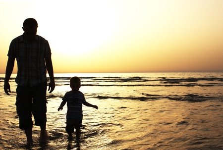 Dad and son at sunset photo