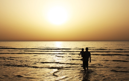 Father and son watched together at sunset photo