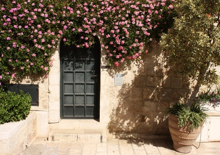 Yemin Moshe - one of the areas of Jerusalem  A beautiful door with flowers  photo