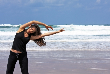 woman during fitness on sea beach photo
