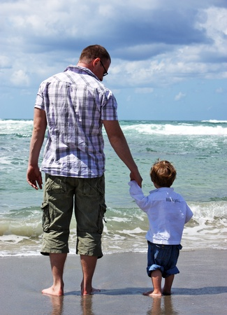 father and son in the sea  photo