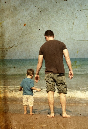 father and son on the beach  Photo in old image style  Stock Photo - 12973428