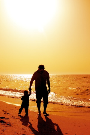 Dad and child on the beach at at sunset Stock fotó